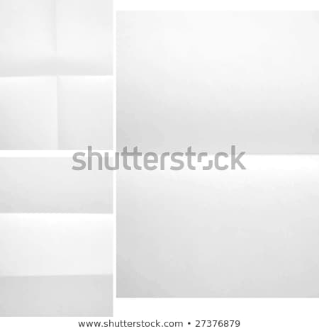 Old yellowing folded A4 paper isolated on white. Stock photo © latent