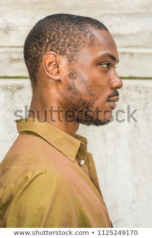 casual man outdoor looks to side with shirt unbuttoned Stock photo © feedough