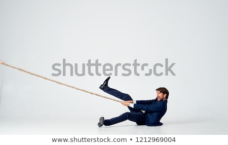 Young Arab pulling a rope isolated on white Stock photo © vlad_star