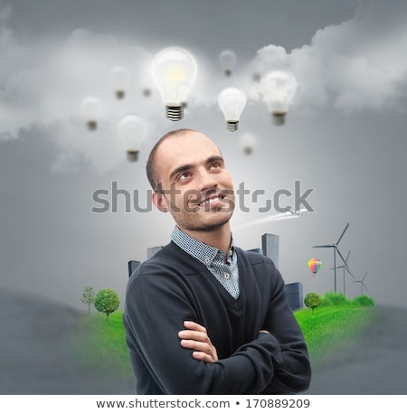 Ecology ideas concept. Businessman standing in front of cityscap Stock photo © hasloo
