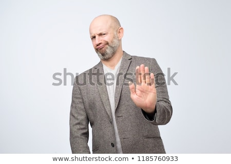 man showing disgust Stock photo © ichiosea