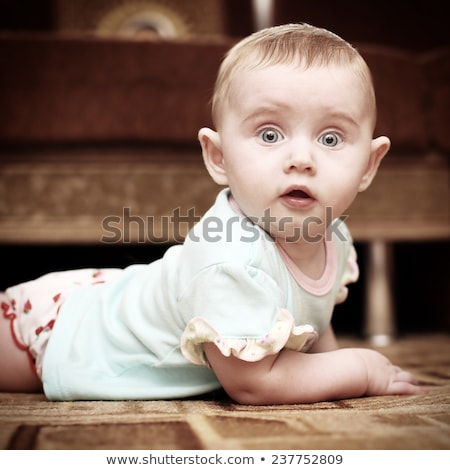 astonished baby on floor stock photo © gewoldi