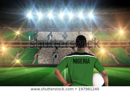 Soccer ball with Nigeria flag on pitch Stock photo © stevanovicigor