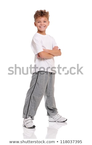 Cheerful teenage boy standing arms crossed Stock photo © CandyboxPhoto