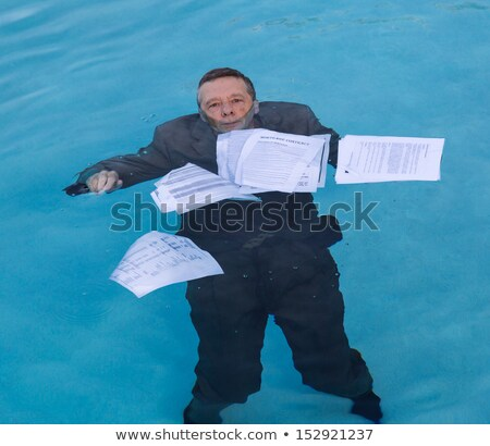 Senior business man in deep water in suit Stock photo © backyardproductions