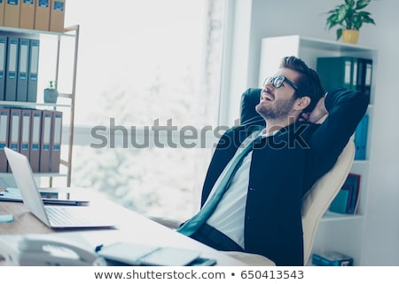 başarılı · işadamı · genç · takım · elbise · gülümsüyor · kamera - stok fotoğraf © runzelkorn