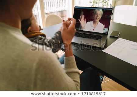 working mom is greeted by her young daughter stock photo © tab62