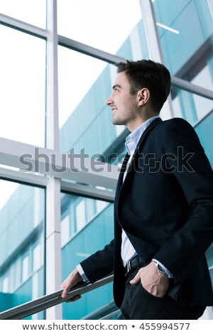 relaxed man with hands in pockets looking down the stairs stock photo © feedough