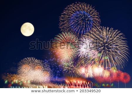 Woman at Fireworks at Full Moon Stock photo © piedmontphoto