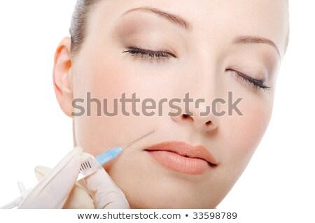 Cosmetische injectie mooie jonge gezicht Stockfoto © dash