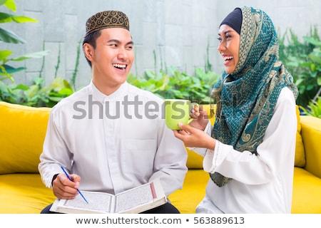 muszlim · férfi · olvas · jóképű · izolált · fehér - stock fotó © kzenon