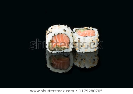 Roll with salmon, cucumber and sesame. Stock photo © dariazu