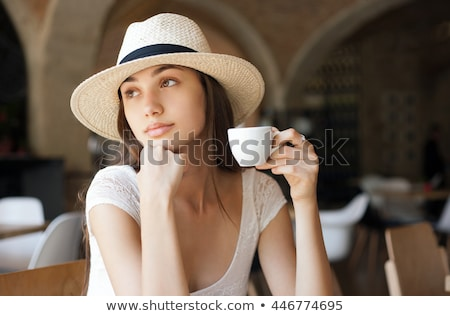 elegant gorgeous young brunette woman with a cup of gourmet coffee stock photo © lithian