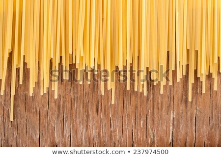 uncooked spaghetti posted on the a row  Stock photo © OleksandrO