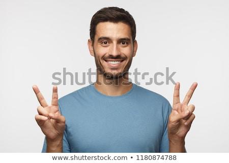 快樂 男子 顯示 勝利 簽署 手勢 商業照片 © deandrobot