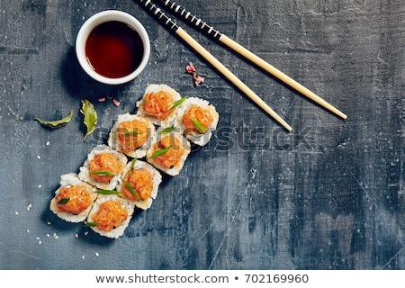 sushi rolls with tuna and salmon plate stock photo © anna_leni