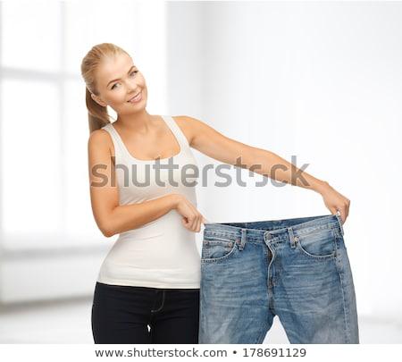 Fitness vrouw tonen groot pants duim omhoog Stockfoto © deandrobot