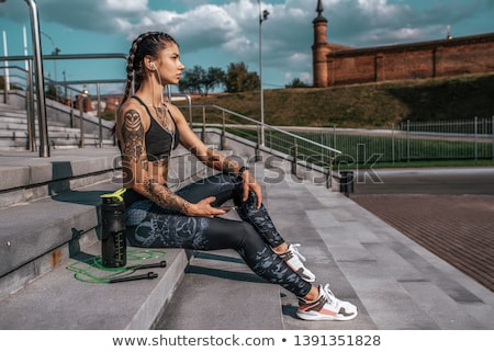 tattooed legs stock photo © iofoto