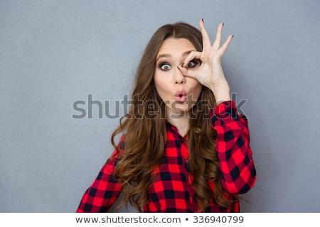 Vicces fürtös lány mutat oké kézmozdulat Stock fotó © deandrobot