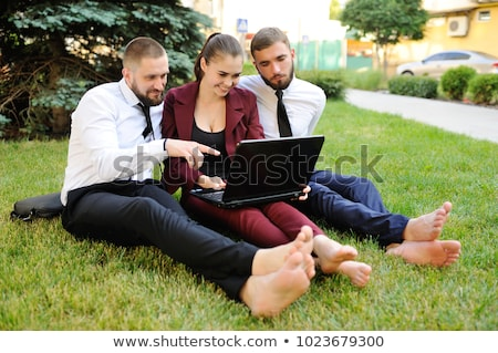 Businessman sitting on the meadow barefoot Stock photo © Paha_L