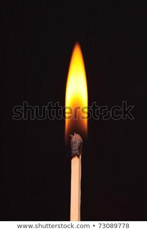Burning matchstick on black background Stock photo © smeagorl