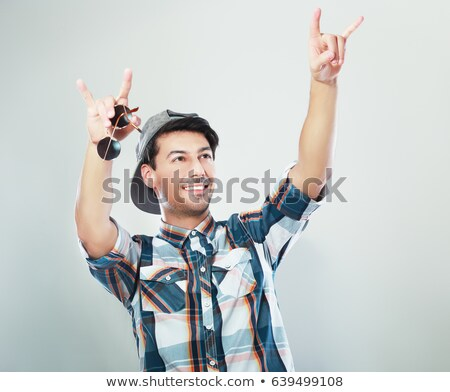 Mão rocha assinar masculino Foto stock © Leftleg