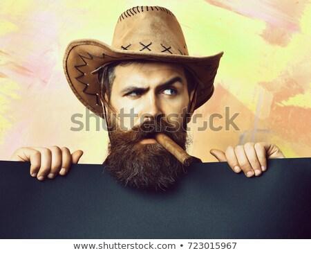 Hairdresser with cowboy hat Stock photo © MilanMarkovic78