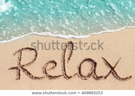 viajar · escrito · praia · mar · paisagem · assinar - foto stock © lunamarina