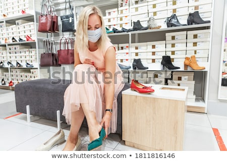 blond with shoe Stock photo © lubavnel