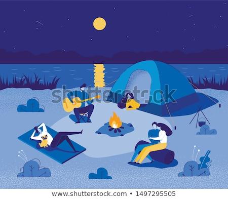 Mulher sessão fogueira camping jovem Foto stock © RAStudio