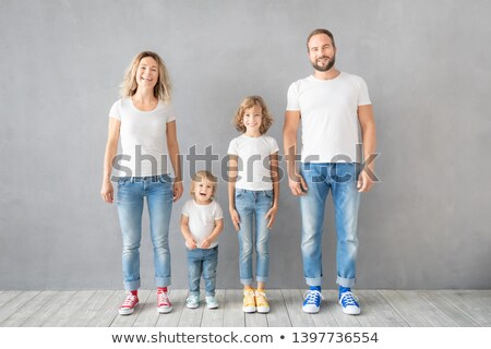 Portrait of happy mother and daughter standing against wall Stock photo © wavebreak_media