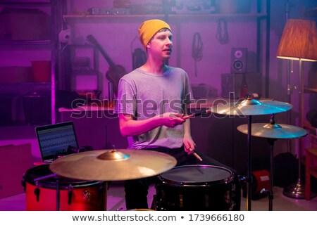 барабанщик · играет · изолированный · черный · стороны · вечеринка - Сток-фото © wavebreak_media