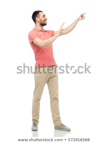 Heureux homme toucher quelque chose imaginaire Photo stock © dolgachov