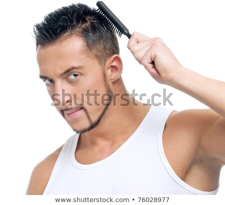 close up of the head of a young man and the hands of a hairstyli stock photo © kzenon