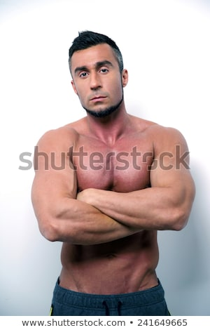Serious shirtless man with arms crossed Stock photo © wavebreak_media