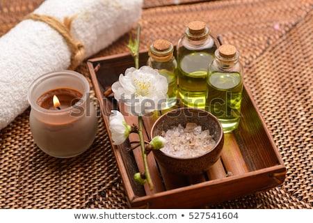 Spa setting with massage oil Stock photo © dashapetrenko