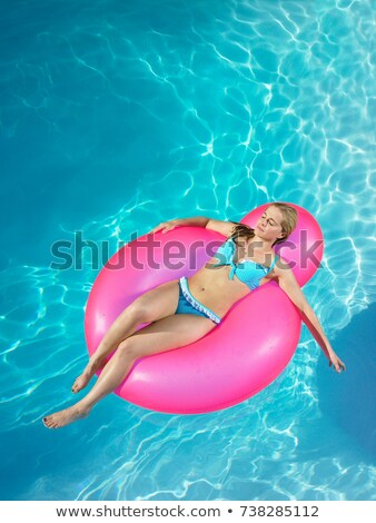 Girl asleep on inflatable chair in pool stock photo © IS2
