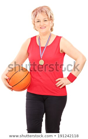 mature lady with medal cheering Stock photo © IS2