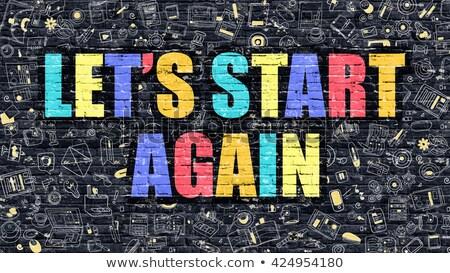 Lets Start Again on Dark Brick Wall. Stock photo © tashatuvango