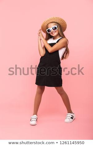 Full length portrait of a wondering little girl Stock photo © deandrobot