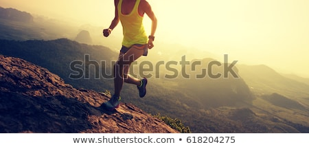 Trail running girl in mountains, inspiration and motivation stock photo © blasbike