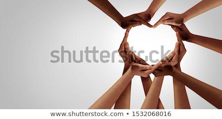Közösség szeretet emberi kezek gyártmány szív alak Stock fotó © psychoshadow
