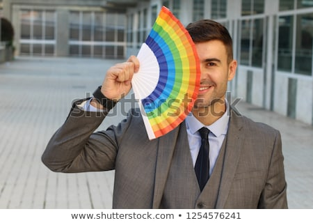 young man with a rainbow flag Stock photo © nito
