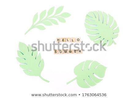 paper cut word HELLO on wooden background Stock photo © balasoiu