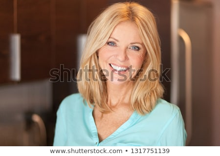 Portrait of a mature woman with blond hair and blue eyes Stock photo © IS2