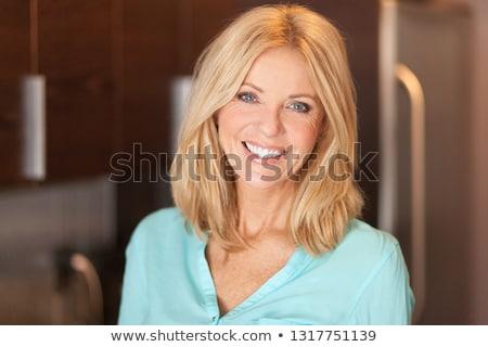 Portrait blond cheveux yeux bleus femme Photo stock © IS2