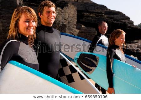 fiatal · lány · áll · szörfdeszka · tengerpart · aranyos · óceán - stock fotó © is2