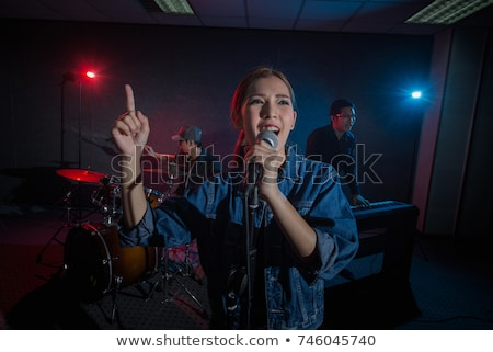 Woman singing in a band Stock photo © IS2
