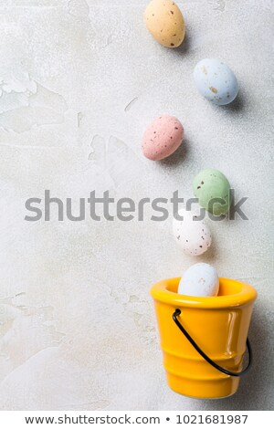 Easter flat lay with yellow ceramic bucket Stock photo © Melnyk
