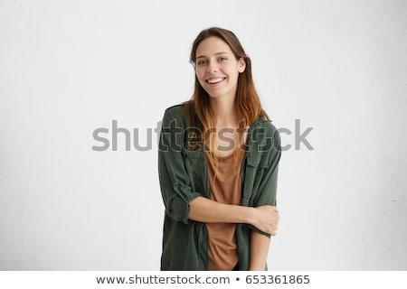 Sorridente mulher jovem cabelo castanho camisas um Foto stock © Giulio_Fornasar